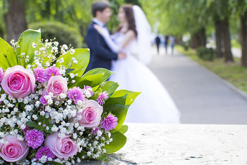 Boquet In Front of Couple